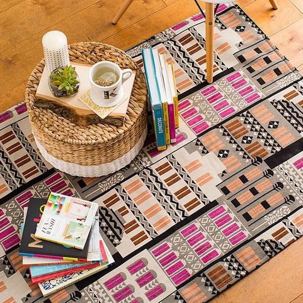 Make Over Your Living Room With This Cheap + Easy Rug Hack