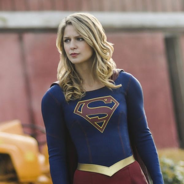 melissa benoist as female superhero supergirl in a red and blue uniform