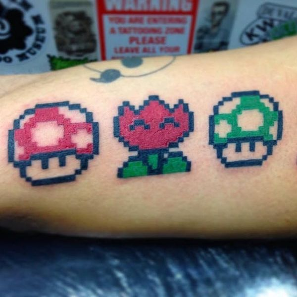 12 Pixelated Tattoo Ideas for a '90s Twist on Your Next Ink