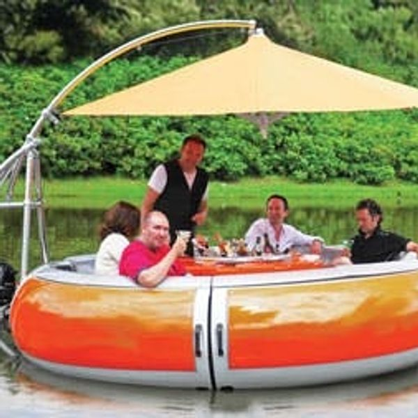 What's Better Than a Swim-Up Bar? A Barbecue Dining Boat