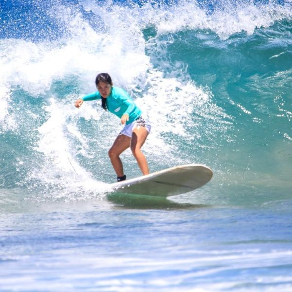 15 Beach Destinations Where You Can Learn to Surf