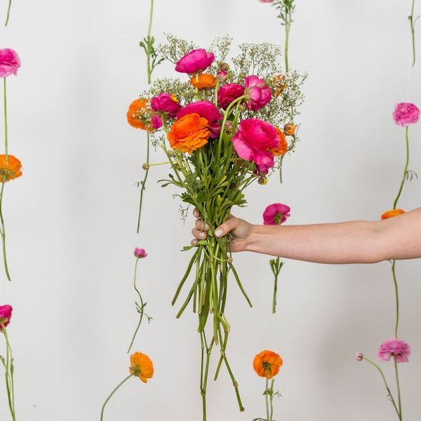 This DIY Flower Backdrop Wall Is *Perfect* for Spring Parties