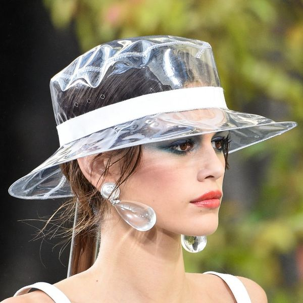 Chanel's Plastic Rain Hats Will Cost You More Than $1K