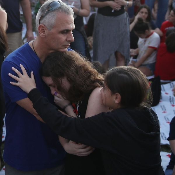 In the Aftermath of Wednesday's Deadly School Shooting, a Nation Debates Next Steps
