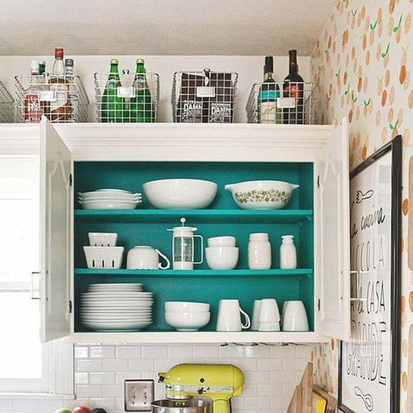 10 Genius Ways to Use That Awkward Space Above Your Kitchen Cabinets