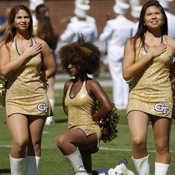 Here's the Unexpected Story Behind the Viral #TakeAKnee Cheerleader Photo