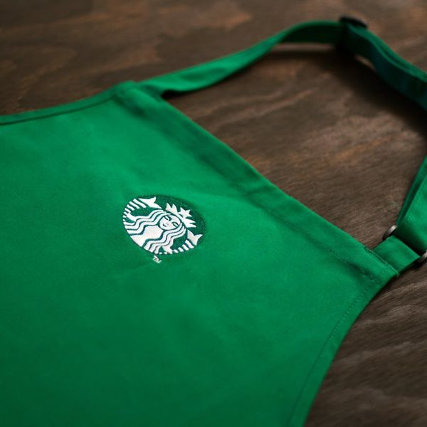 Here's the *Real* Reason Starbucks Baristas Wear Those Green Aprons