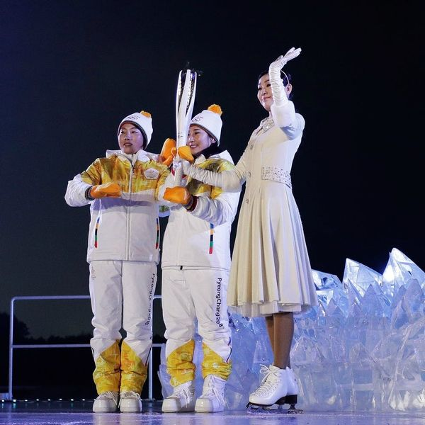 The Story Behind the Two Women Carrying the Olympic Torch Together Will Warm Your Heart