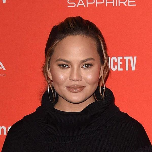 Chrissy Teigen Mocks  Her '00s Spray Tan in This Hilarious Grammys Throwback