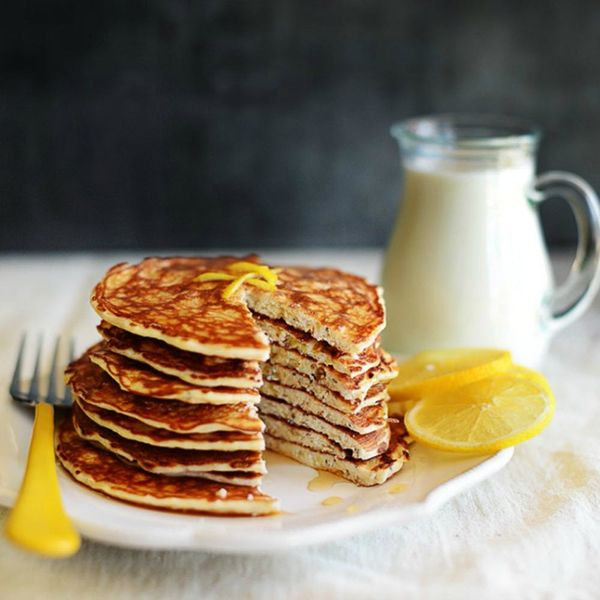 A stack of chia seed pancakes on a white plate with lemon slices is one of 25 healthy chia seed recipes to explore.