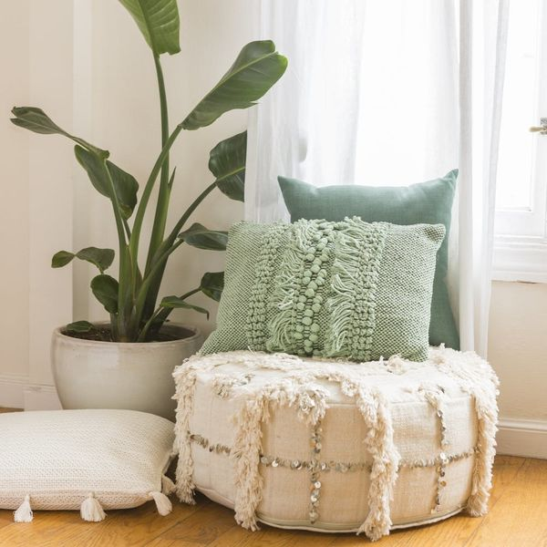 18 Poufs and Ottomans Under $150 That Are Perfect for Your Next Party