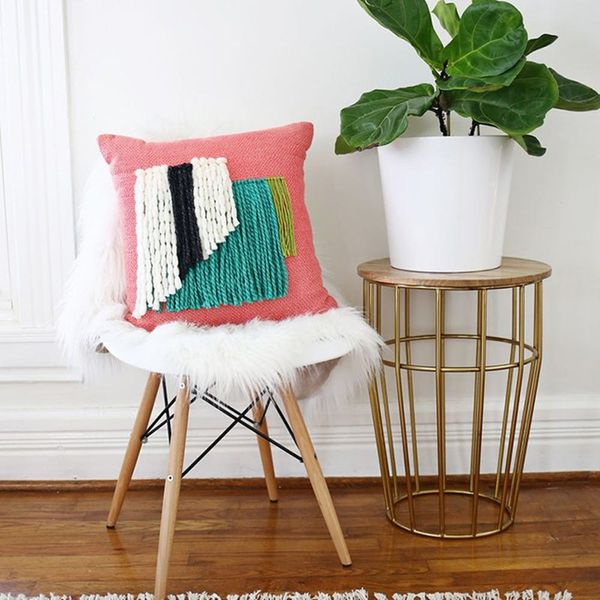10 Cozy Pillow Upgrades You Can Make With Just a Little Bit of Yarn