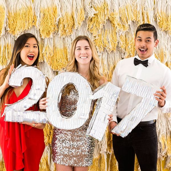 Take All the Pics With This Gilded New Year's Eve Photo Booth Backdrop