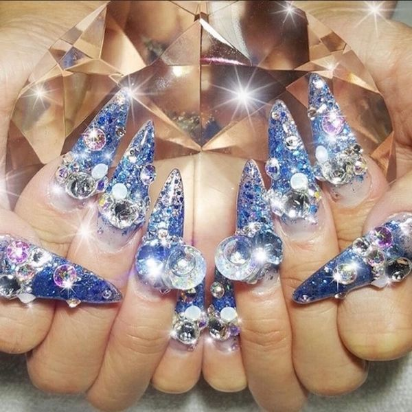 These Snow Globe Nails Are the Most Festive Way to Decorate Your Fingertips