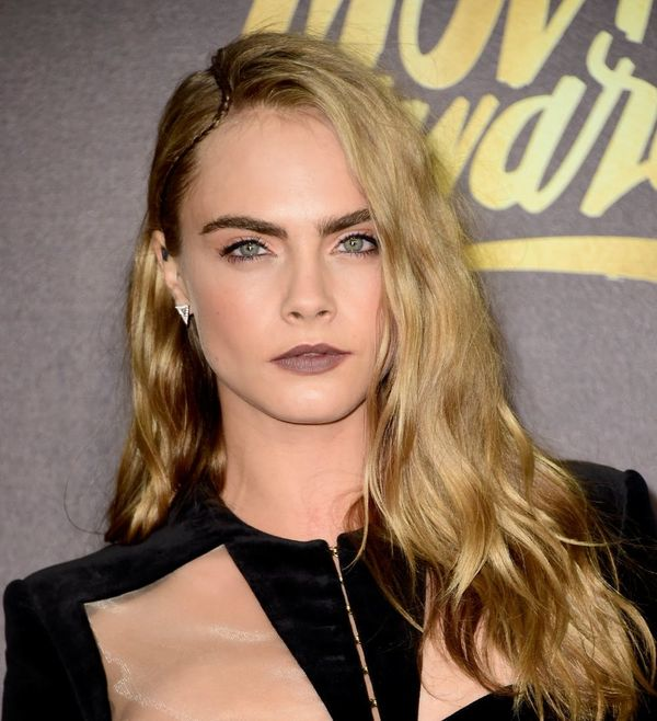 The Meaning Behind Cara Delevingne's Side Tattoo Is Super Touching