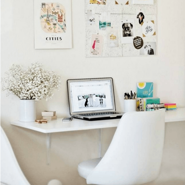 A Wall-Mounted Table Does Double-Duty in a Small Space