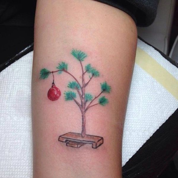 17 Holiday Tattoos You Need to See Now