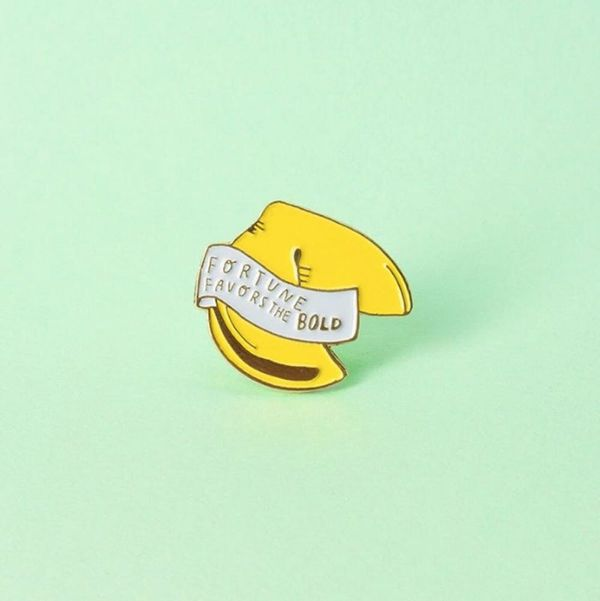 These New Celeb-Designed Inspirational Pins Just Became Your Newest Closet Staple