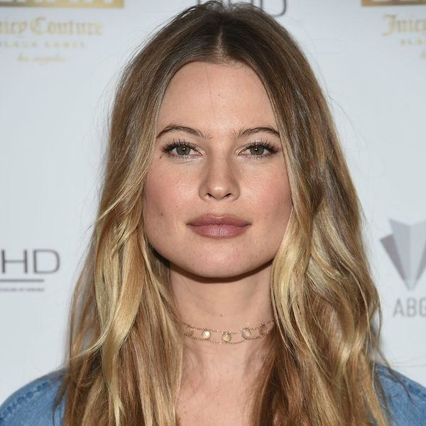 Behati Prinsloo Uses Her Baby Bump As a Floatation Device in This Hilarious Snap