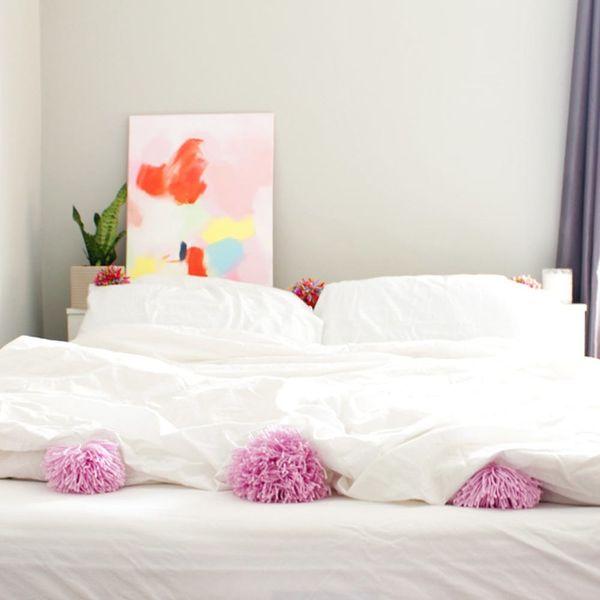 Upgrade Your Bedding With DIY Pom Pom Pillows and Duvet