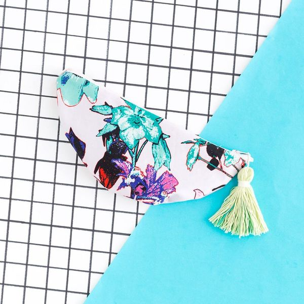 This DIY Tasseled Clutch Doubles As a Bridesmaid's Survival Kit