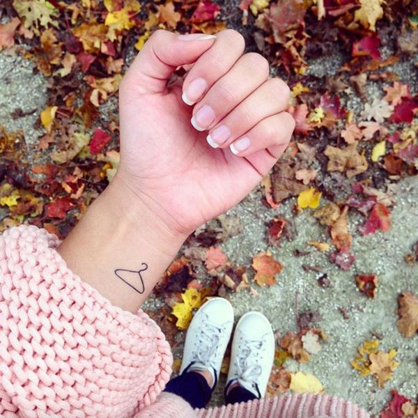 12 Minimalist Line Tattoos That Show Less Is More