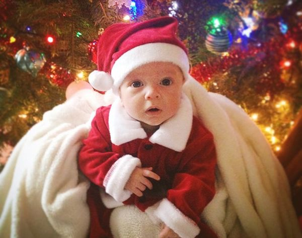 Holiday Cute Overload: 16 Pets + Babies Pretending to Be Santa