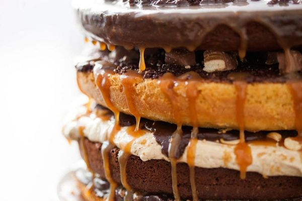 Introducing Our Candy Bar Cake! Four Layers of Twix, Snickers, Heath Bars, and Rolos Galore!
