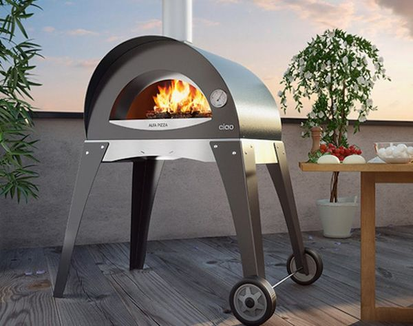 This Portable Grill Cooks Up Wood-Fired Pizza in Your Backyard