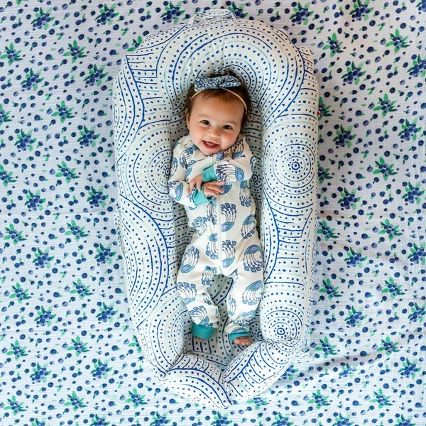 This Colorful Baby Lounger is Essential for Adventurous New Parents