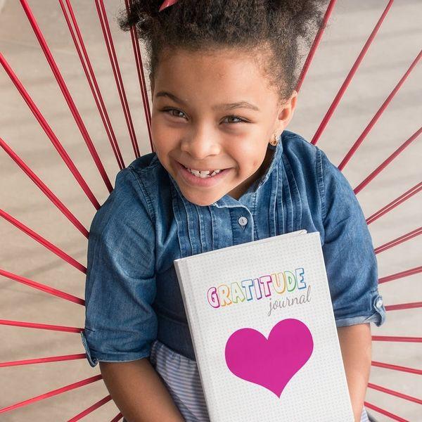 Girl with gratitude book