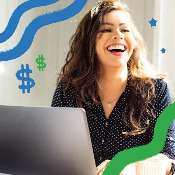 woman laughing at computer laptop