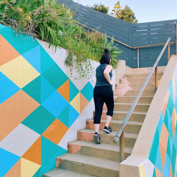 girl climbing running stairs in los angeles silver lake steps