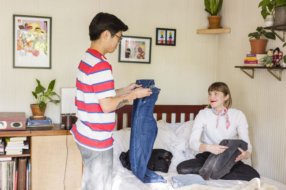 couple folding clothes together