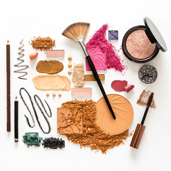 Flat layout of various colors and sizes of beauty products.