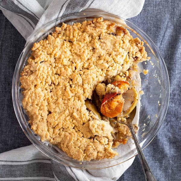 This pie has a spoon lifting up persimmons on a delicious looking crumble on an apple oat pie makes for one of many great persimmon recipes.