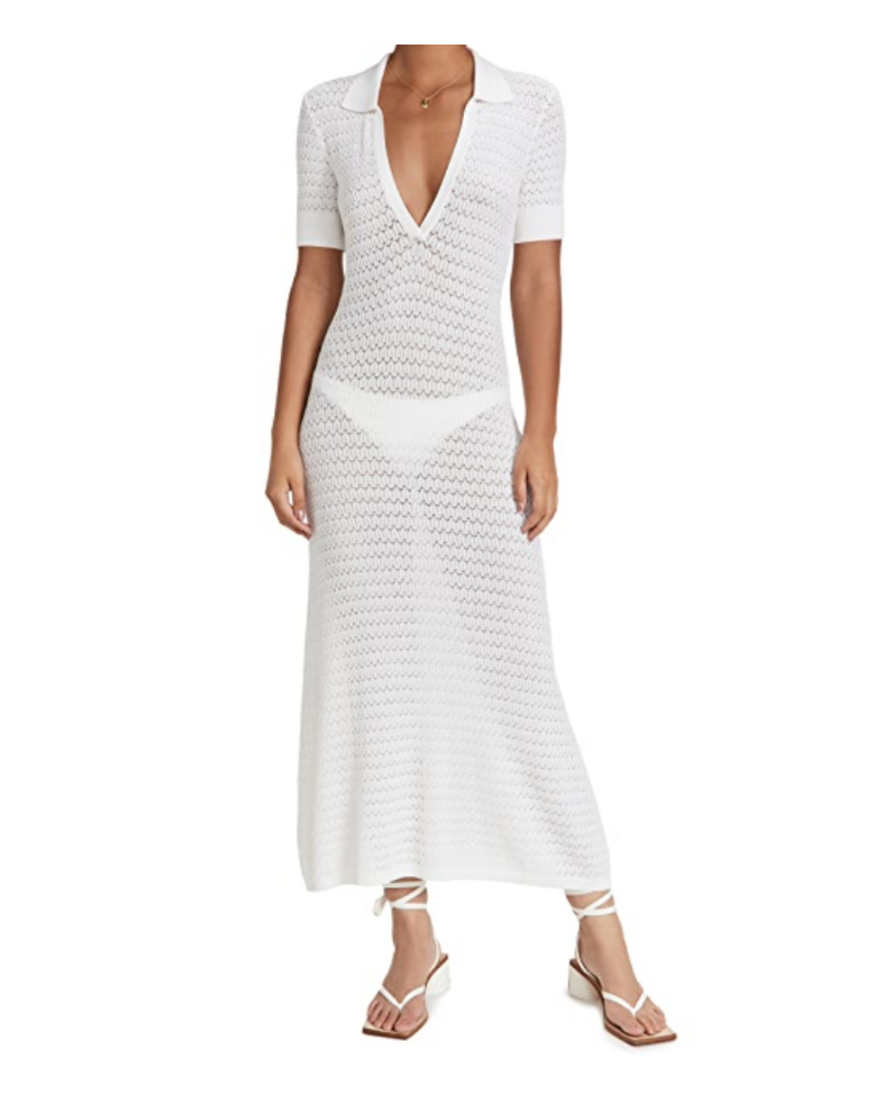 model wears white cover up dress with matching white sandals