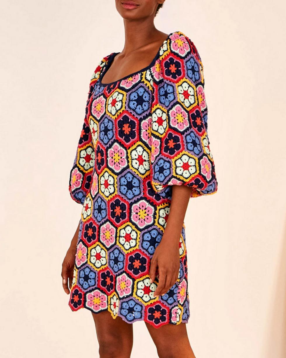 model wears multi colored flower crochet mini dress