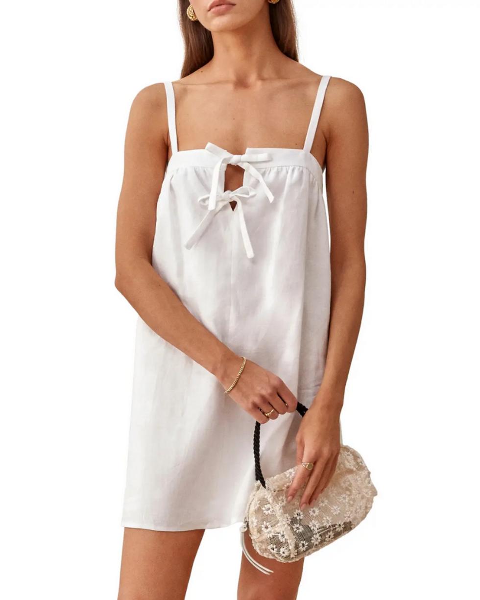 model wears white linen slip dress