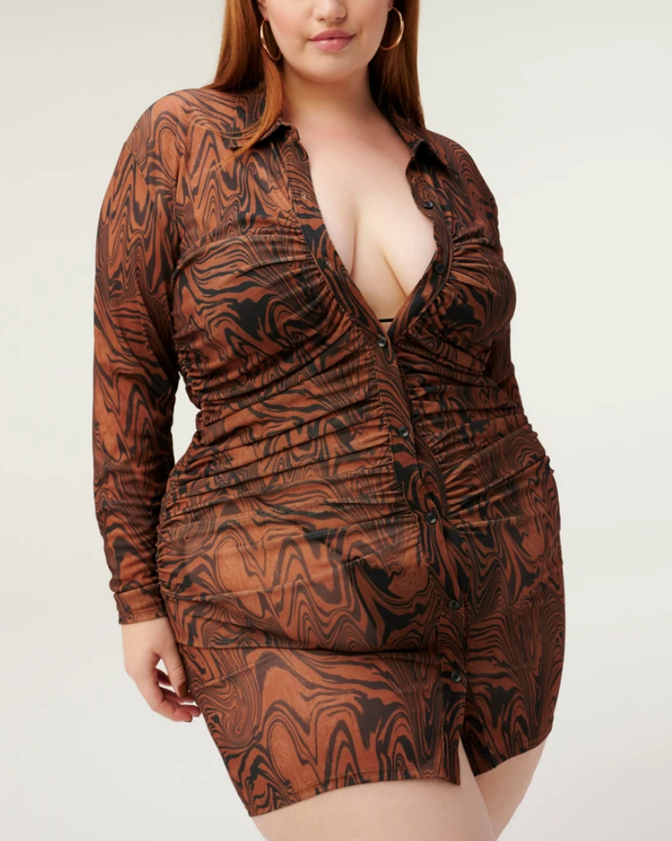 model wears orange and brown psychedelic mesh button up dress