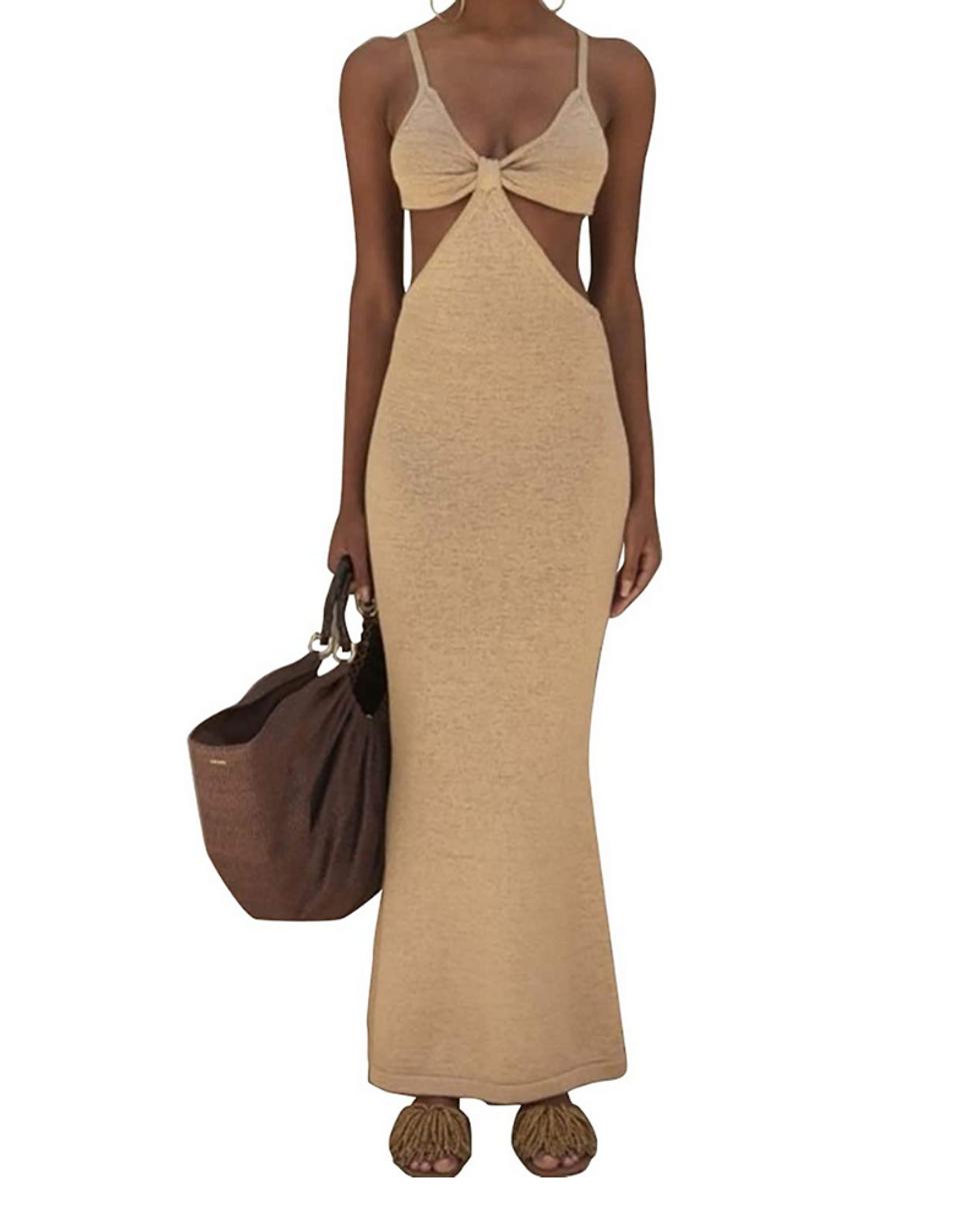 model wears tan knit beach dress
