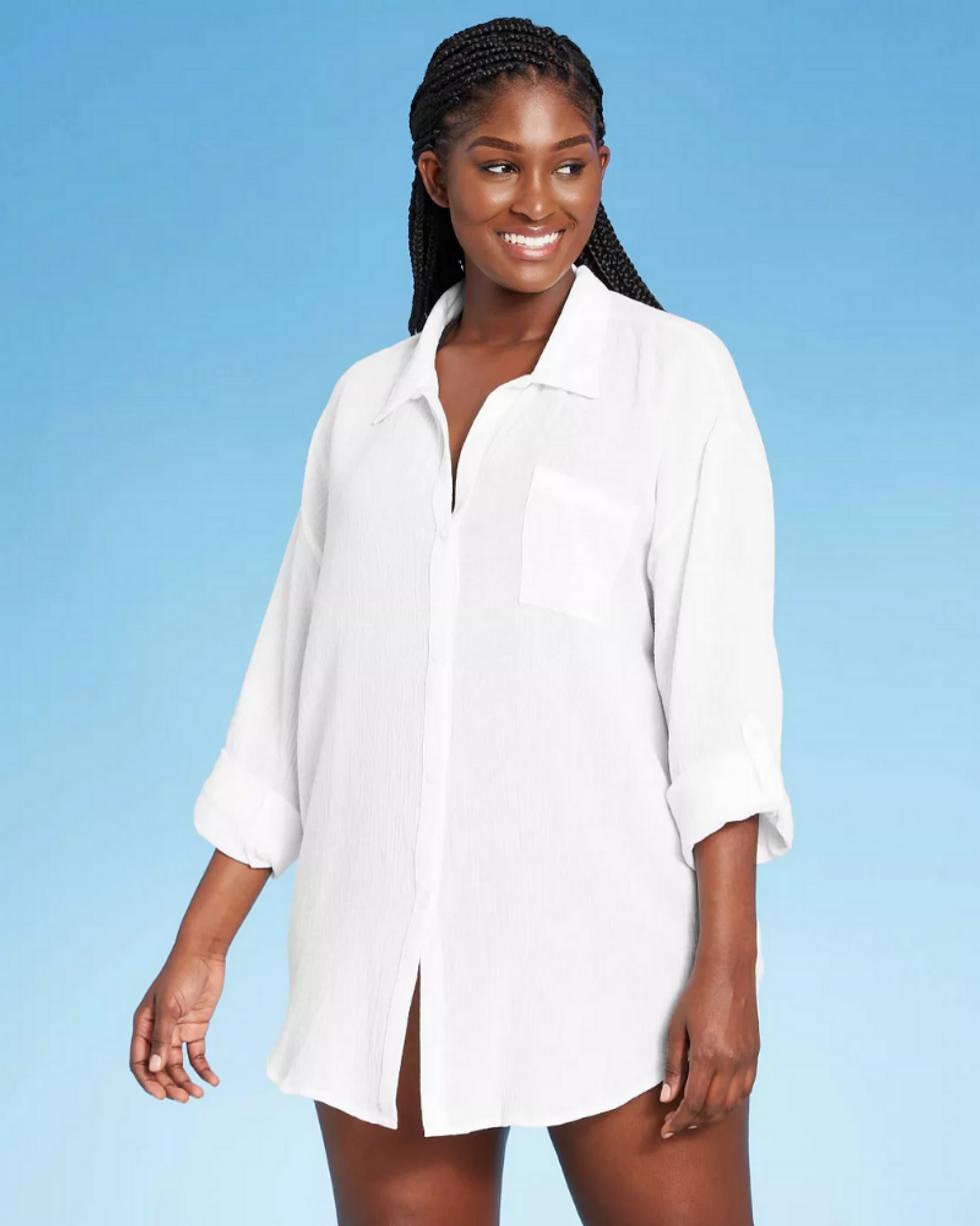 model wears white shirtdress to wear to the beach