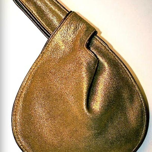 Hate Purses? You'll Love The CLICK Bag